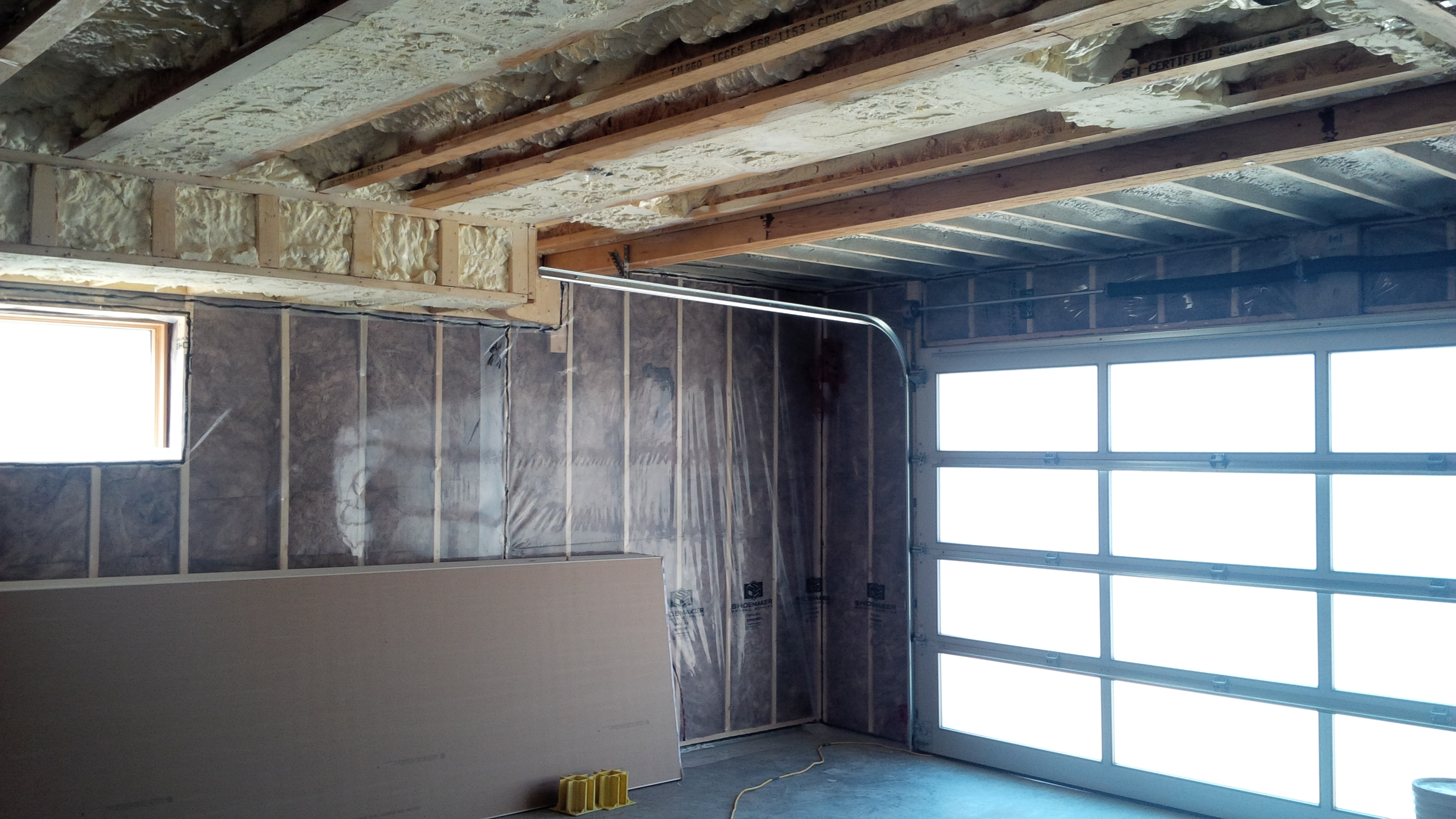 spray foam insulation installed in garage common ceiling