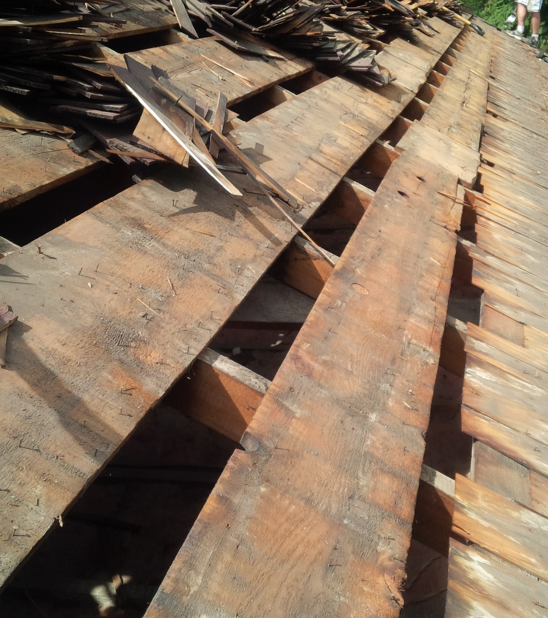 wood shake tear off reveals gaps in roof deck