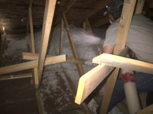 attic installation of loose-fill fiberglass