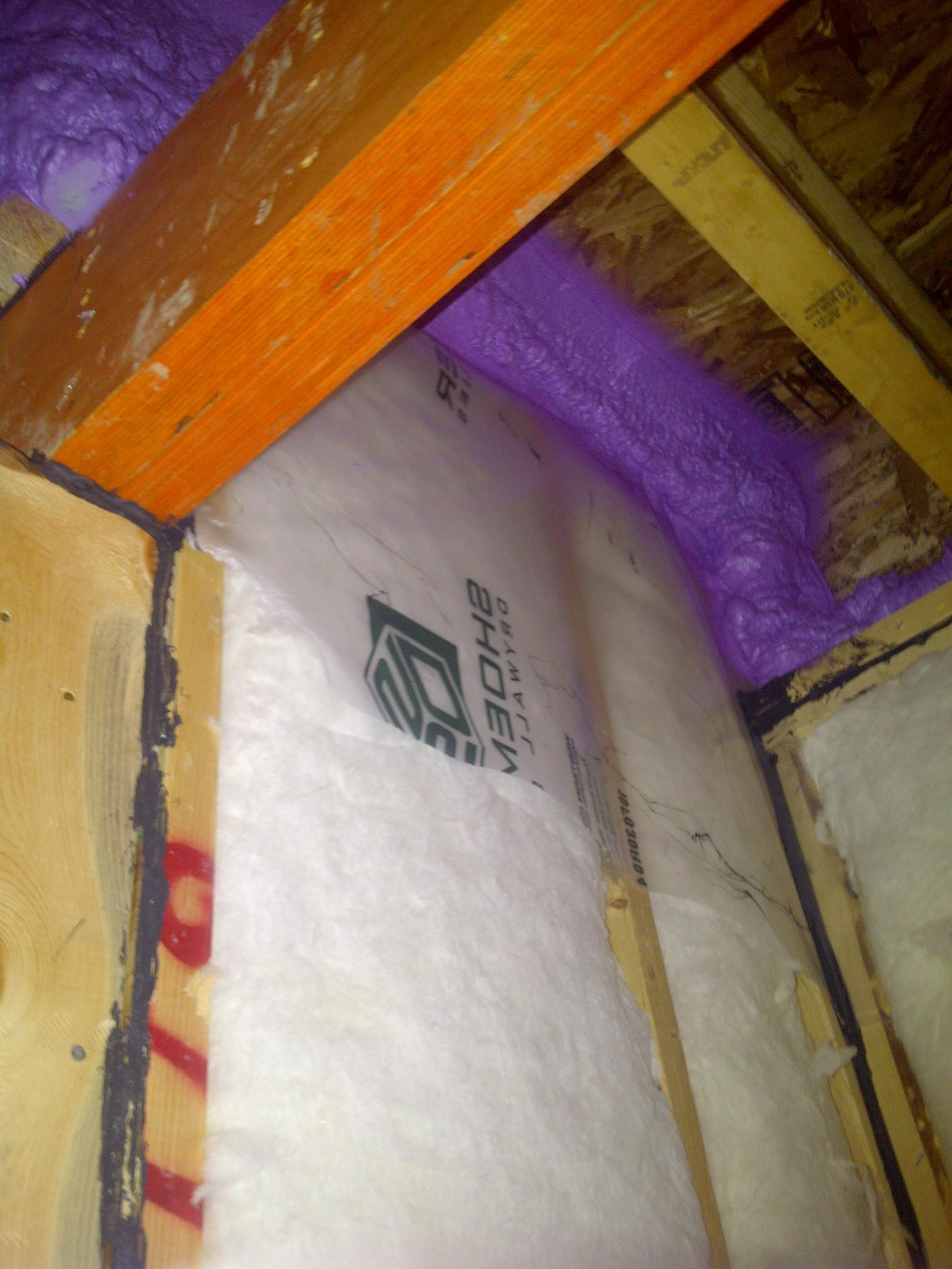 spray foam insulation complementing fiberglass batts