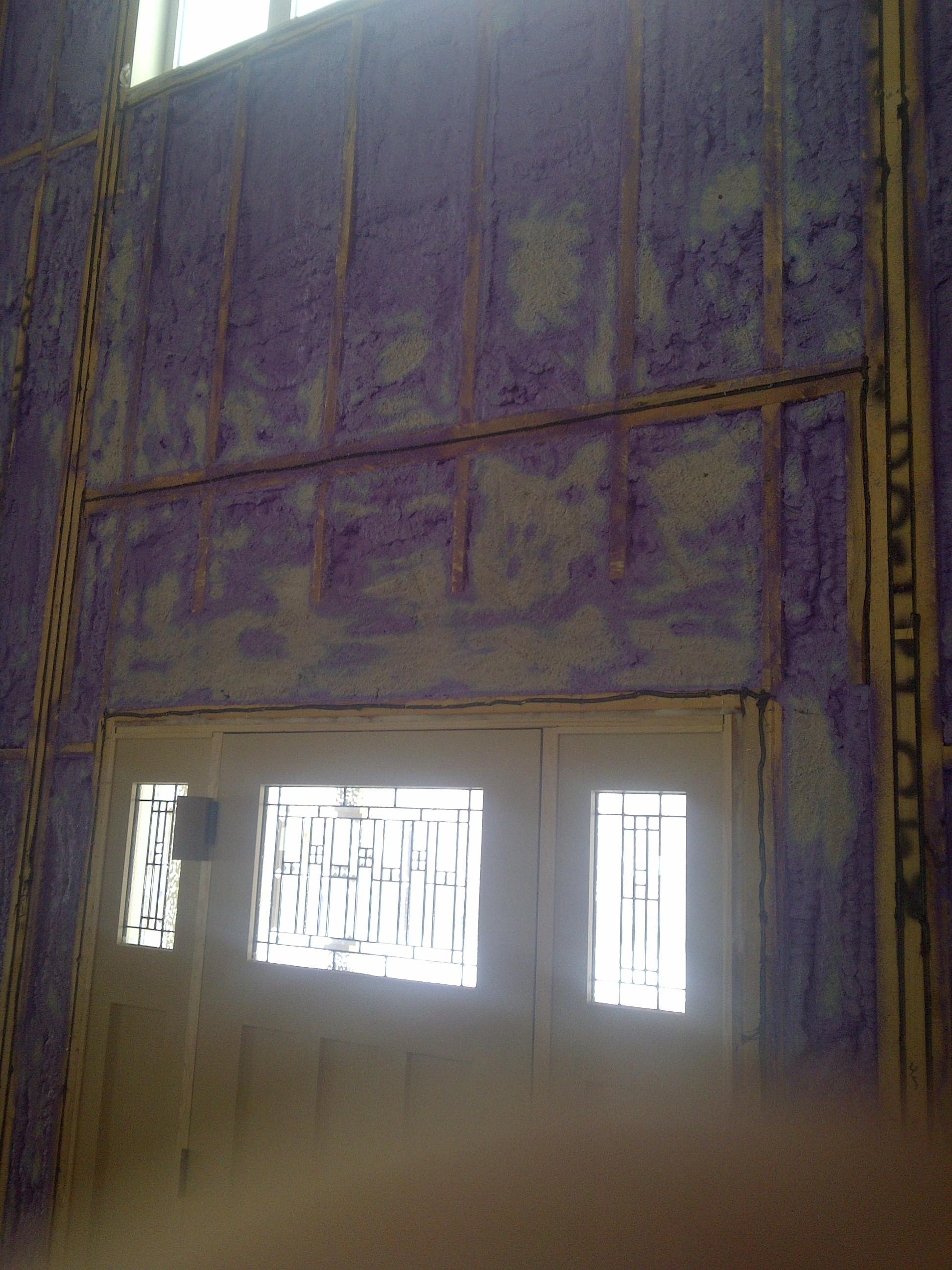 spray foam insulation installed around entry way