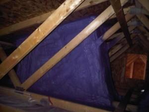 spray foam insulation installed around skylight cavity