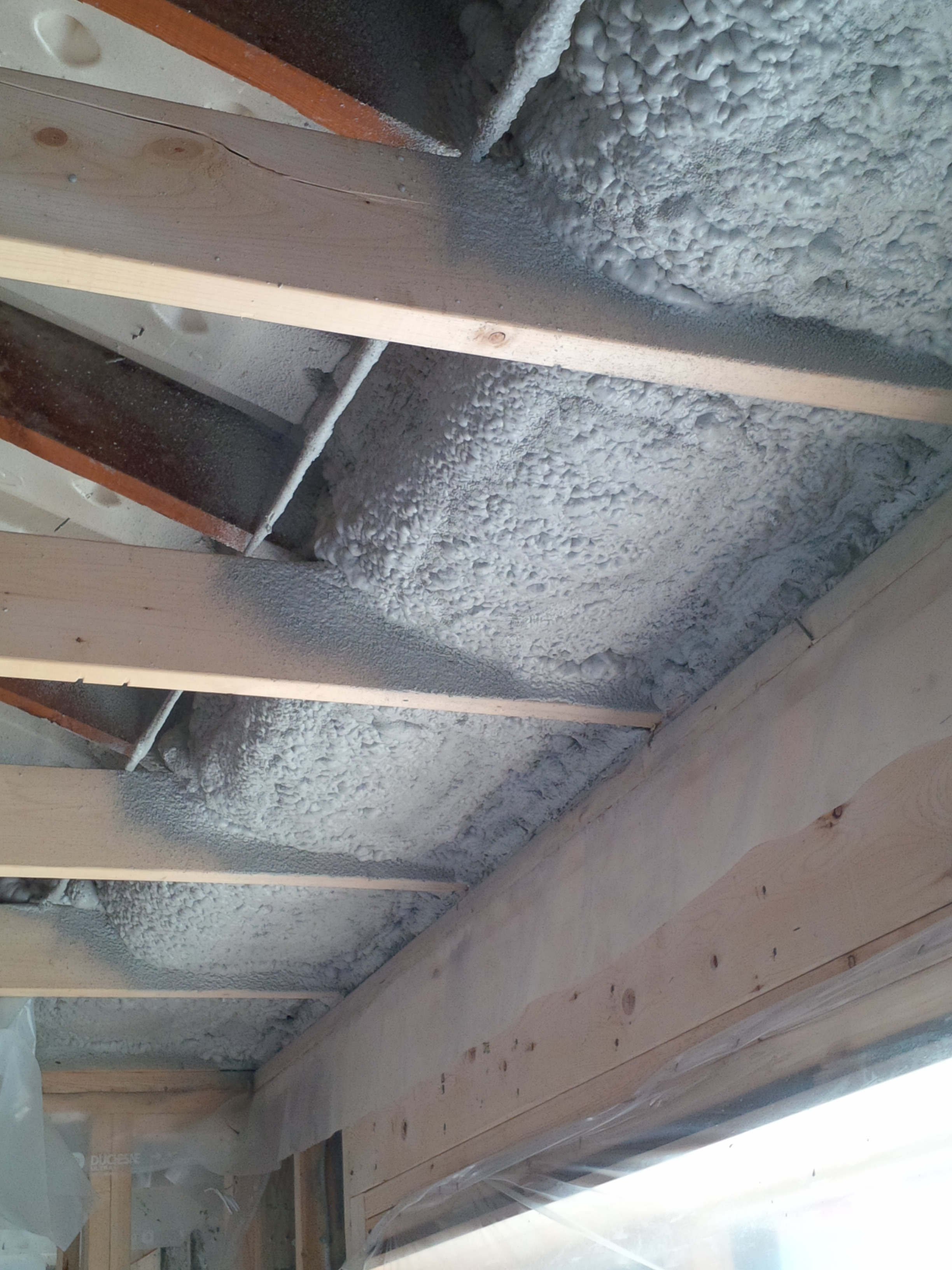 spray foam insulation installed under air chutes