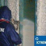 icynene installer using spray foam in treated wall cavity